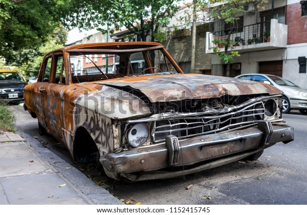 Abandoned rusty car in a street in Buenos Aires, Argentina