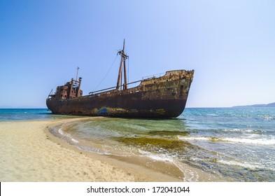 Abandoned and rusty shipwreck near Gytheio, Greece.