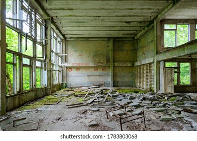 """Abandoned school gym in large resettled village of Pogonnoe in Chernobyl exclusion zone, Khoiniki district, Belarus. Text on wall: """"From pioneer starts"""""""