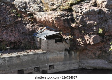 An abandoned shack from a closed mine sits just above the white water river flowing through Colorado's Royal Gorge