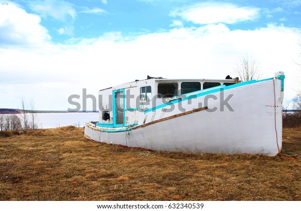 Abandoned ship on the side of the shore.