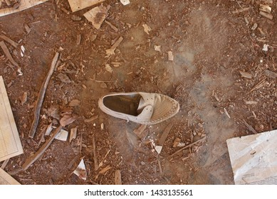 An Abandoned Shoe and Abandoned Building