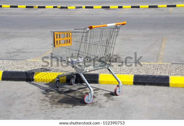 An abandoned shopping trolley on a parking place