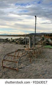 Abandoned and sinking play submarine playground equipment on the shore of a desert lake (Salton Sea).