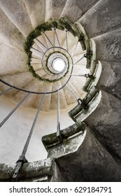 Abandoned spiral staircase in baroque italian villa