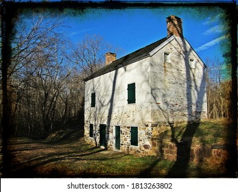 An abandoned stone lock house sits barren in the woods along the C&O Canal Towpath and the Potomac River in rural Maryland.