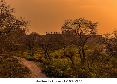 The abandoned temple complex walls at Fathepur Sikri, India glows after sunset