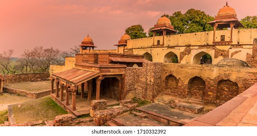 The abandoned temple complex walls at Fathepur Sikri, India glows in the sunset light