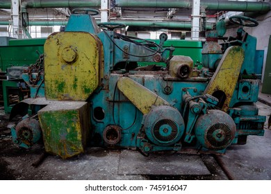 Abandoned tire factory with rusted machine tools