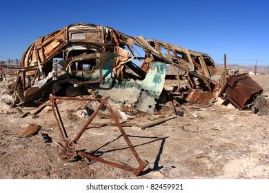 Abandoned trailer and bicycle at Salton Sea Beach