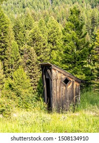 Abandoned two seater outhouse in woods