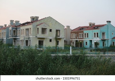 Abandoned underbuilt / not finished housing project. Bankruptcy in building industry. World economic crisis. Blocks of empty town houses started to get destroyed.
