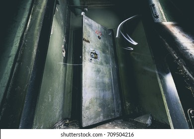 Abandoned underground ex Soviet cold war bomb shelter. Ghostly figure walking through. Atmosphere of fear. Exclusive quest and rage room design. The bunker. End of the world. Depression and emptiness.