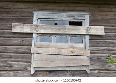abandoned and unfinished wooden house in the countryside, a close-up of the construction with clogged windows and unfinished other elements