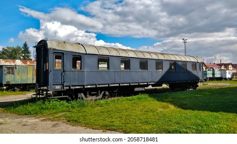 Abandoned unused railway carriage outside of the train station during beautiful weather.