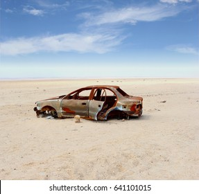 Abandoned vintage car wreck on white desert background, Skeleton Coast Namibia, Africa