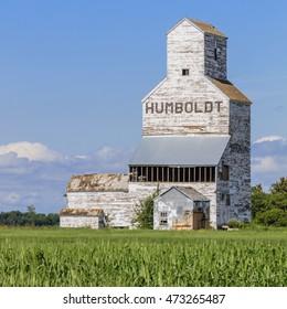 Abandoned vintage white grain elevator near Humboldt, Saskatchewan on the Canadian prairies.