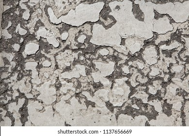 Abandoned wall painted white. Background texture.