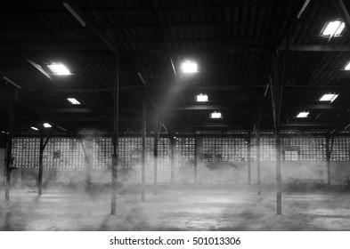 Abandoned warehouse. Black and white image. noise scene.