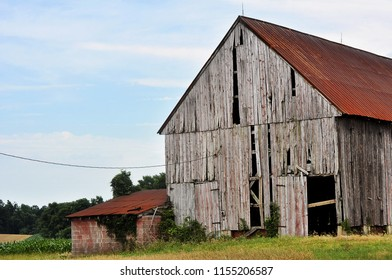 An abandoned and weathered barn.