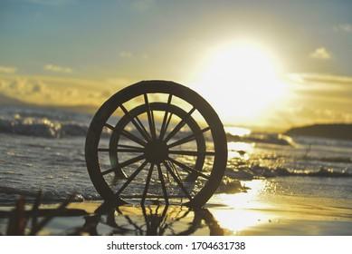 Abandoned wheel under the sunshine