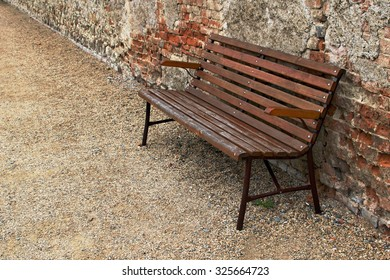 Abandoned wooden bench in the street