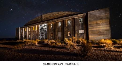 Abandoned WWII Wooden Aircraft Hangar near Tonopah, Nevada at night with stars