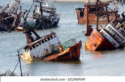 Abandoneold rusty ships in the Port of Montevideo, Uruguay. Old ship grave yard.