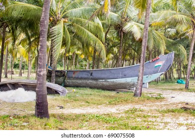 Abandonned artistic wooden canoe on a lonely beach in India, Kerala
