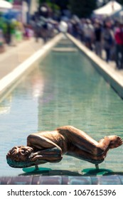 ABANO, ITALY. May 10, 2015: Spa long fountain of Abano Terme in Italy. Bronze statue sleeping on water.