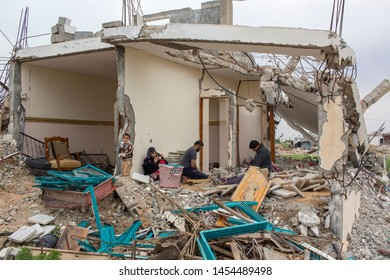 Abasan al-Kabira, Gaza Strip/Palestine - feb 24 2015 :  some residents work at their homes destroyed by bombing and recover iron