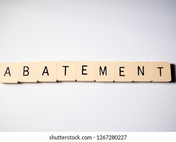 Abatement word made with blocks on white table. Top view