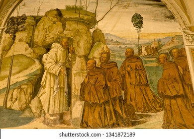Abbey of Monte Oliveto Maggiore, Siena, Tuscany - Italy, March 7, 2019: Fresco depicting Saint Benedict who matures the idea of a community monasticism, different from the hermitic isolation.