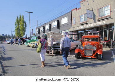 ABBOTSFORD - AUGUST 20, 2016: People enjoy a vintage car show in old downtown Abbotsford, BC, Canada on August 20, 2016.