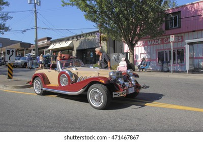 ABBOTSFORD - AUGUST 20, 2016:  People enjoy a 2007 Gatby Cabrolia Kit car during the vintage car show in old downtown Abbotsford, BC, Canada on August 20, 2016.
