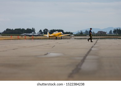 ABBOTSFORD, BC, CANADA - AUG 11, 2019: The RCAF CF-18 with a Harvard in the foreground on the tarmac at the Abbotsford International Airshow.