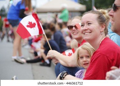 ABBOTSFORD, BC/CANADA  ?? JULY 1 2016: A mother and her young daughter watch a parade during Canada Day celebrations in Abbotsford, BC on July 1, 2016.
