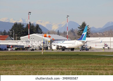 ABBOTSFORD, BC/CANADA - MARCH 29, 2016:A Canadian Westjet passenger plane is parked in the Abbotsford airport terminal on March 29, 2016.