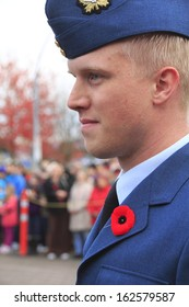 ABBOTSFORD, BRITISH COLUMBIA/CANADA -Â?Â? NOVEMBER 11: A young Canadian army cadet watches the Remembrance Day ceremony on November 11, 2013 in Abbotsford, British Columbia, Canada.
