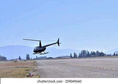 ABBOTSFORD, CANADA - MARCH 08: Aerobatic helicopter displays for civilian at the International Aerospace event on March 08, 2015 in Abbotsford, Canada.