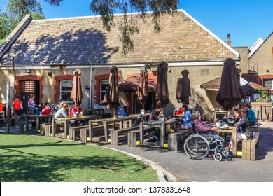Abbotsford, VIC/Australia-March 6th 2018: People enjoy their meals at outdoor dinning area at Convent Bakery.