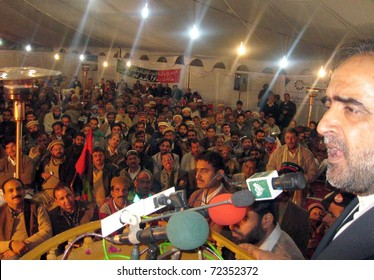 ABBOTTABAD, PAKISTAN - MAR 02: Secretary Information Pakistan Peoples party ( PPP ) Qamar Zaman Kaira addressing a public gathering on March 02, 2011in Abbottabad.
