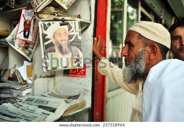 ABBOTTABAD, PAKISTAN - MAY 15: Pakistani man reading newspapers and daily life on May 15, 2011 in Abbottabad, Pakistan.
