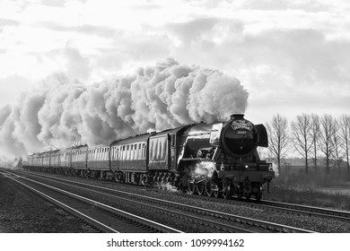 ABBOTTS RIPTON, CAMBRIDGESHIRE, UK - FEBRUARY 25, 2016: LNER Class A3 Pacific No. 60103 Flying Scotsman on a London to York special charter after 10 year restoration. B&W with wires digitally removed.