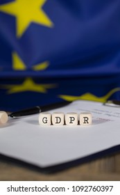 Abbreviation GDPR for General Data Protection Regulation composed of wooden dices. Closeup