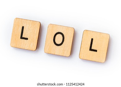 The abbreviation LOL - Laugh Out Loud, spelt with wooden letter tiles.