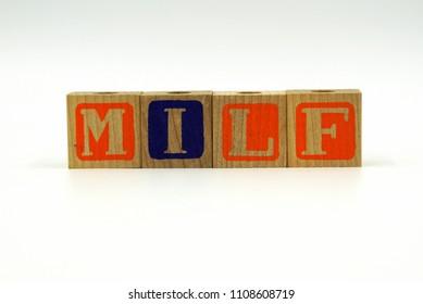 Abbreviation MILF on wood toy blocks