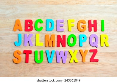 ABC alphabets on wooden background