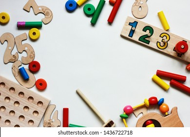 abc, flat lay with natural toys for the development of children after school, numbers letters cubes and puzzles and puzzles on the table, cars and other materials from wood on a white background