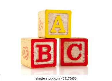 ABC on old vintage educational blocks isolated over white